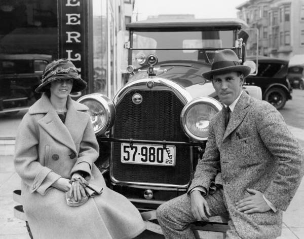 Photograph - Couple With Their Peerless Car by Underwood Archives