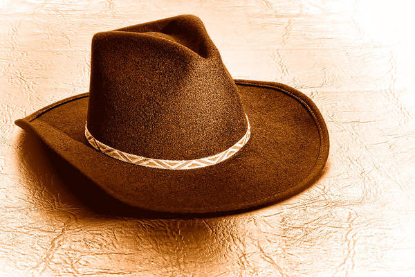 Wall Art - Photograph - Cowboy Hat On Leather - Sepia by Olivier Le Queinec