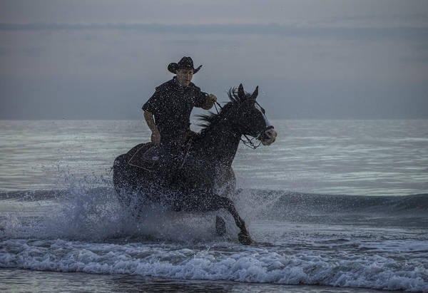 Photograph - Cowboy Riding In The Surf by Dorothy Cunningham