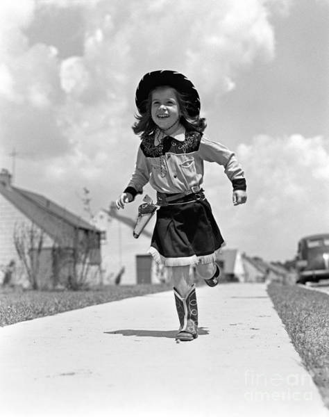 Exuberance Photograph - Cowgirl Running Down Sidewalk, C.1950s by H. Armstrong Roberts/ClassicStock