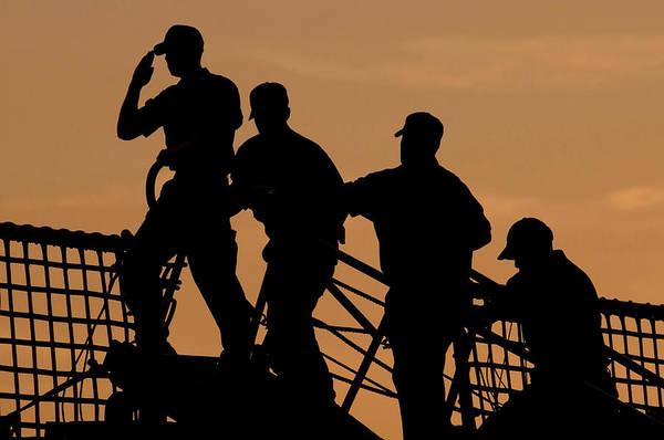 Photograph - Crewmen Salute The American Flag by Stocktrek Images