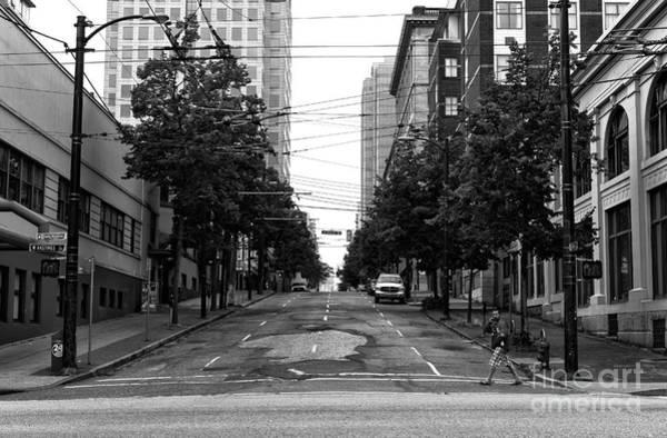 Wall Art - Photograph - Crossing An Empty Street Mono by John Rizzuto