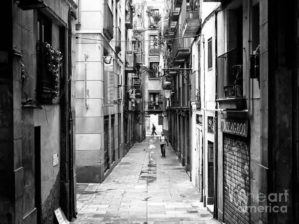 Photograph - Crossing Paths Barcelona by John Rizzuto