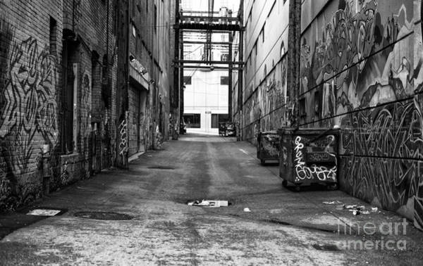 Wall Art - Photograph - Crossing The Alley Mono by John Rizzuto