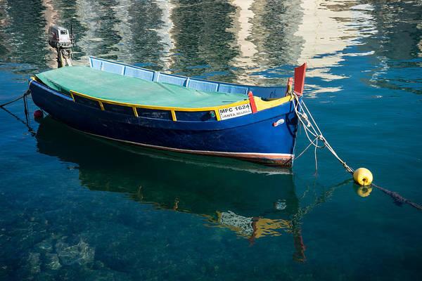 Photograph - Crystal Clear Mediterranean Blue - Maltese Luzzu Fishing Boat At Anchor by Georgia Mizuleva