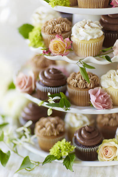 Wall Art - Photograph - Cupcakes And Flowers On Tiered Stand by Gillham Studios
