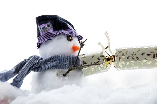 Purple Carrot Photograph - Cute Snowman Pulling A Cracker by Simon Bratt Photography LRPS