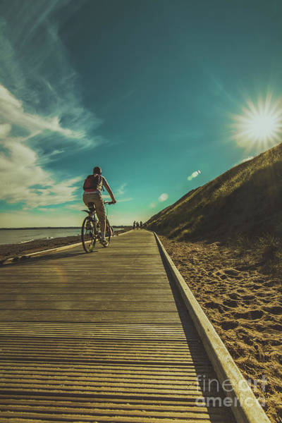 Photograph - Cyclist On Boardwalk by Marc Daly