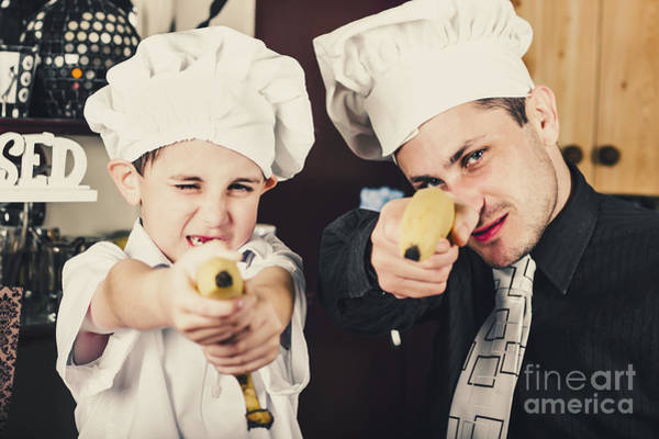 Kindergarten Photograph - Dad And Son Cooks Shooting With Bananas In Kitchen by Jorgo Photography - Wall Art Gallery