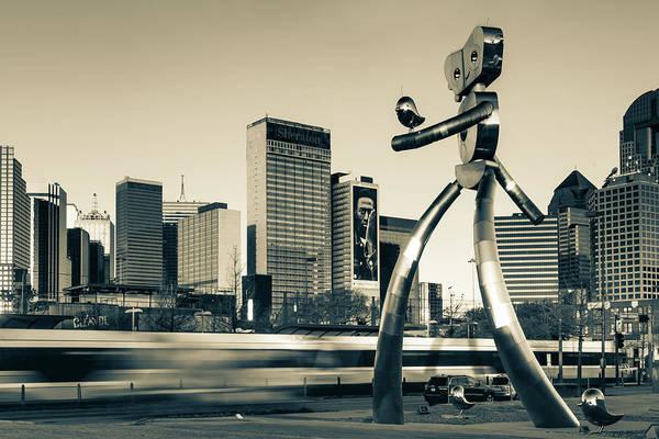 Photograph - Dallas Texas Traveling Man Cityscape - Sepia by Gregory Ballos