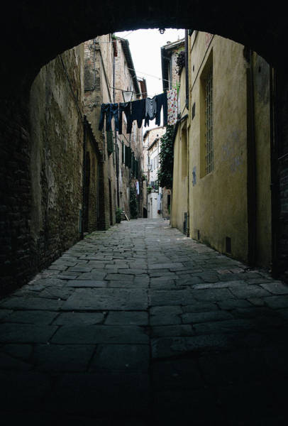 Photograph - Dark Alleyway With Clothes Hanging In Siena, Tuscany, Italy by Alexandre Rotenberg