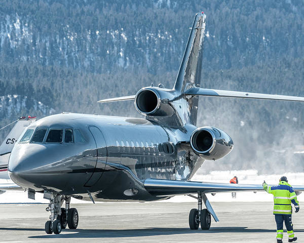 Wall Art - Photograph - Dassault Falcon 900 Parking With Marshaller by Roberto Chiartano