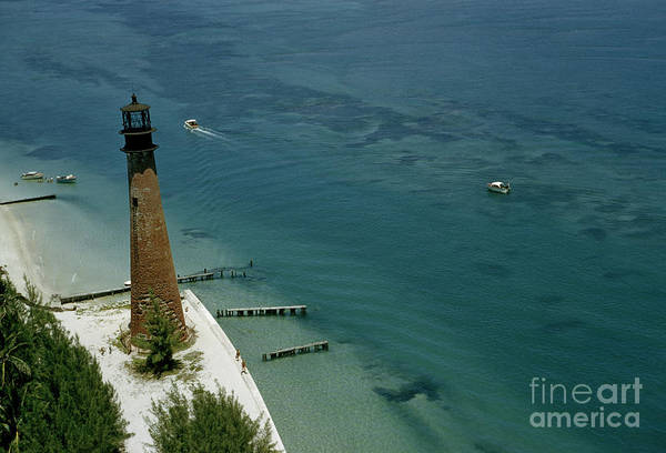 Photograph - Decommissioned Lighthouse Towers Over The Bay by Herbert Wilburn