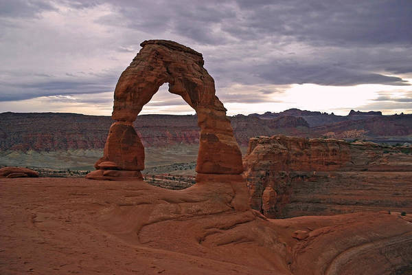 Wall Art - Photograph - Delicate Arch Under Threatening Skies by Brian M Lumley