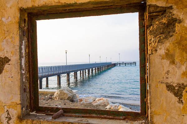 Sea Wall Art - Photograph - Derelict Window And Pier by Iordanis Pallikaras
