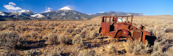 Sagebrush Photograph - Deserted Car With Cow Skeleton, Great by Panoramic Images