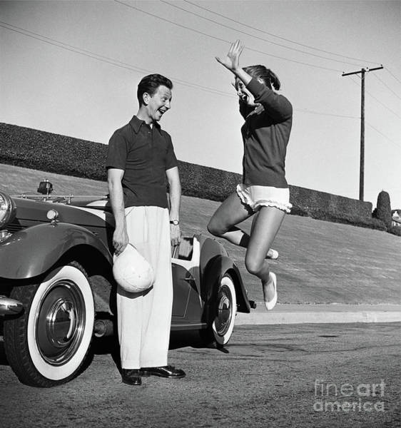 Frank Reynolds Wall Art - Photograph - Donald O'connor And Debbie Reynolds Mid-jump Fine Art Print by Frank Worth