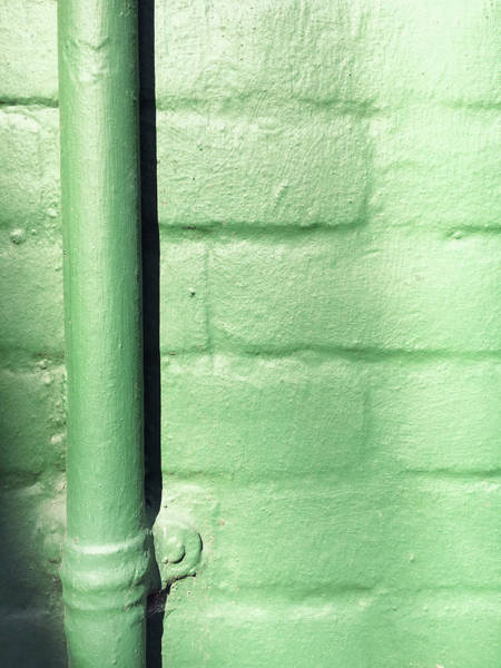 Wall Art - Photograph - Drainpipe On A Wall by Tom Gowanlock