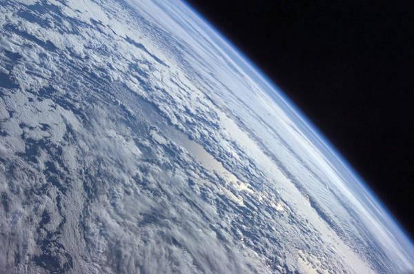 Photograph - Earths Horizon Against The Blackness by Stocktrek Images