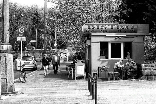 Wall Art - Photograph - Eating Lunch On Karl-marx-allee by John Rizzuto