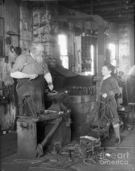 Farrier Photograph - Elderly Blacksmith With Boy, C.1930s by H. Armstrong Roberts/ClassicStock