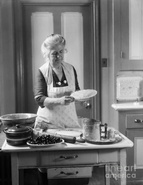 Elder Care Photograph - Elderly Woman Making Pie, C.1920-30s by H. Armstrong Roberts/ClassicStock