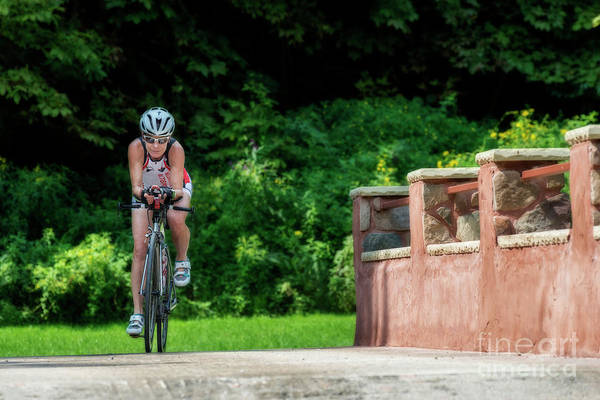 Photograph - Eleonore Cycling Across Bridge by Dan Friend
