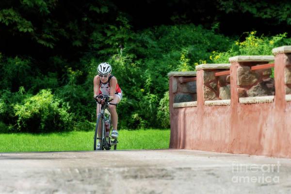 Photograph - Eleonore Cycling On A Bridge by Dan Friend