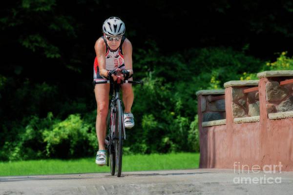 Photograph - Eleonore Cycling On Bridge by Dan Friend