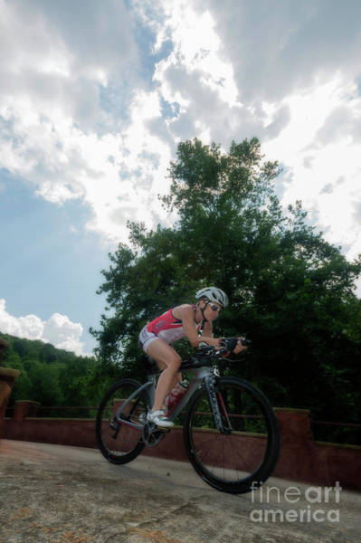Photograph - Eleonore Cycling With Sun Behind Tree by Dan Friend