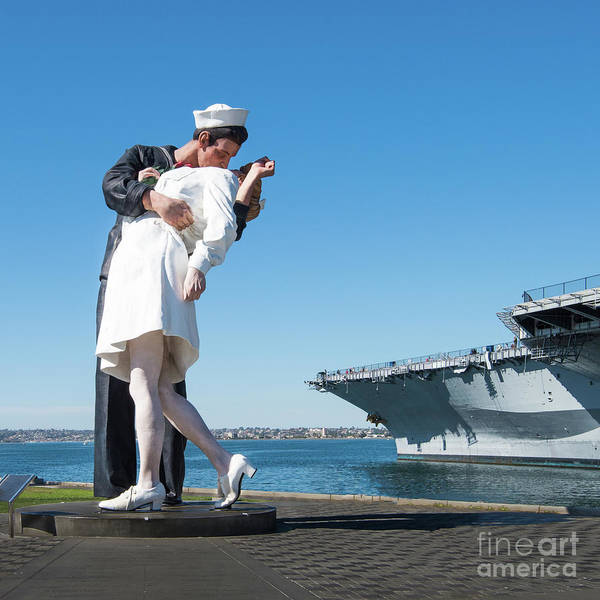 Photograph - Embracing Peace Sculpture And Uss Midway Aircraft Carrier by David Levin