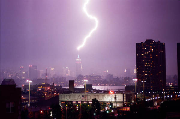 Holland Tunnel Wall Art - Photograph - Empire State Building Hit By Lightning August 2002 by Sean Gautreaux