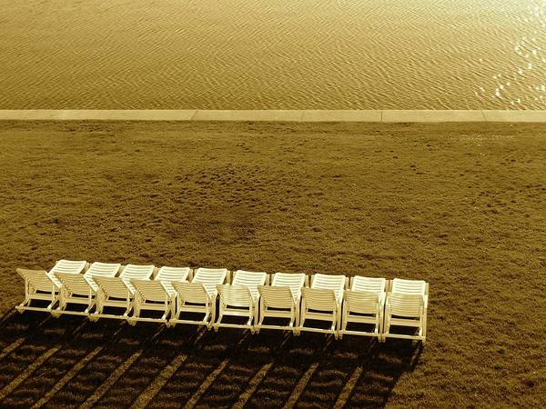 Photograph - Empty Lounge Chairs by Jenny Regan
