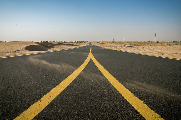 Photograph - Empty Road Through Desert-like Landscape by Alexandre Rotenberg