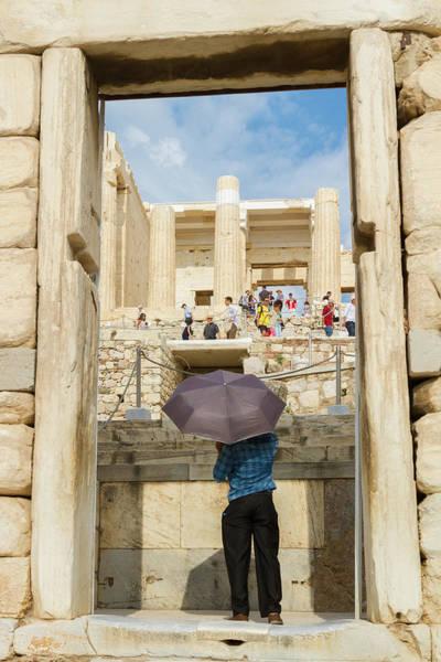 Wall Art - Photograph - Entering The Acropolis Holding An Umbrella by Iordanis Pallikaras