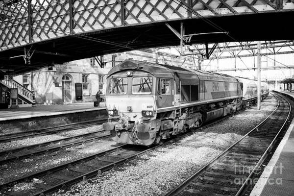 Wall Art - Photograph - Ews Diesel Electric Locomotive Freight Train Passing Through Carlisle Railway Train Station Carlisle by Joe Fox