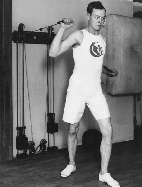 Wall Art - Photograph - Exercising With Weights 2 by Underwood Archives