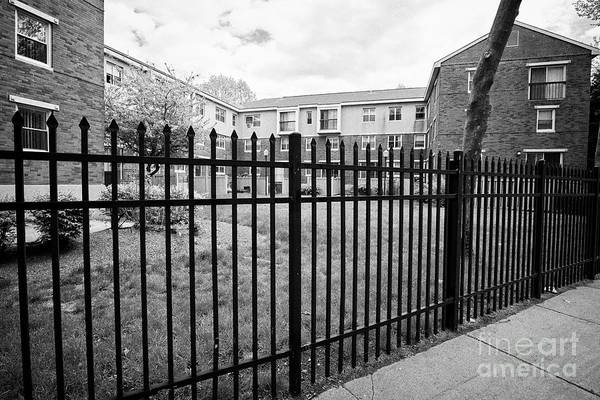 Wall Art - Photograph - exterior enclosing metal fence residents only housing complex Boston USA by Joe Fox