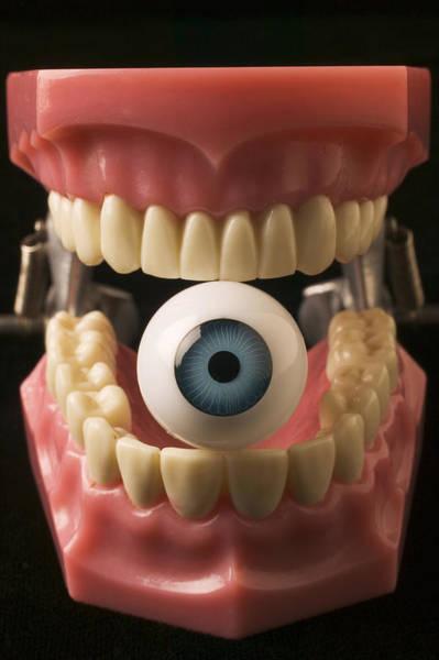 Surrealistic Photograph - Eye Held By Teeth by Garry Gay