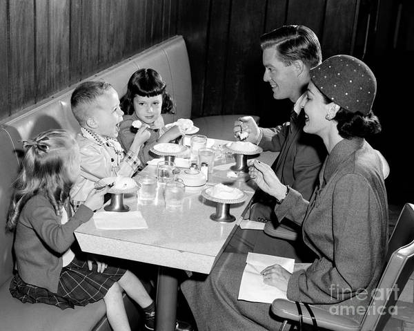 Idealistic Wall Art - Photograph - Family Eating Ice Cream by H. Armstrong Roberts/ClassicStock
