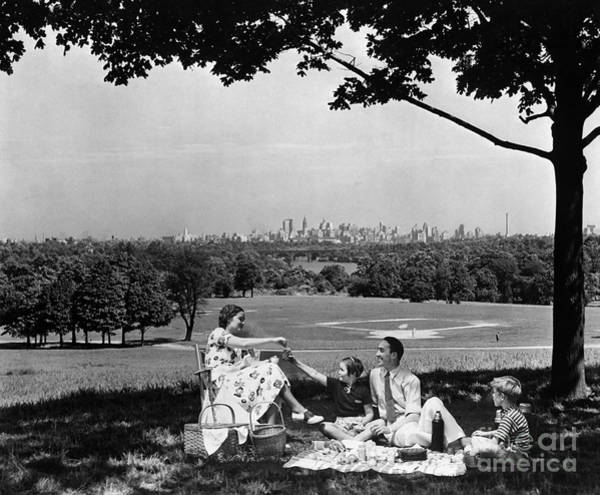 Wall Art - Photograph - Family Picnicking Under A Tree by H. Armstrong Roberts/ClassicStock