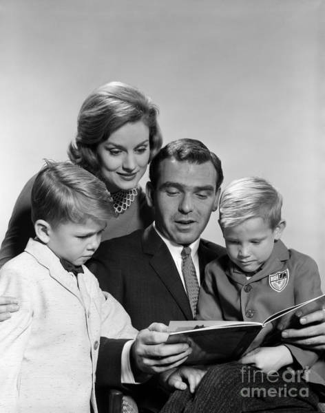 Fathers Day Photograph - Family Reading A Book, C.1960s by H. Armstrong Roberts/ClassicStock
