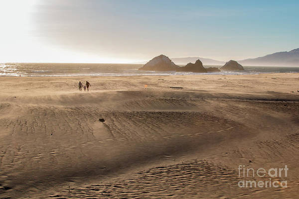 Family Walking On Sand Towards Ocean Art Print