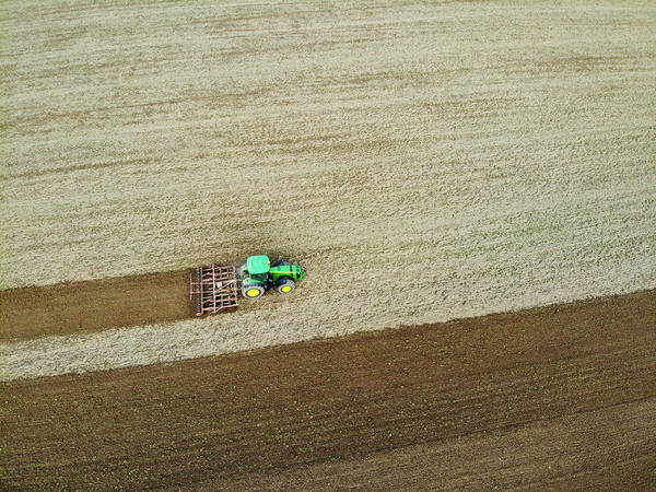 Photograph - Farm Tractor Cutting Furrows In Field Aerial Image by Matthias Hauser