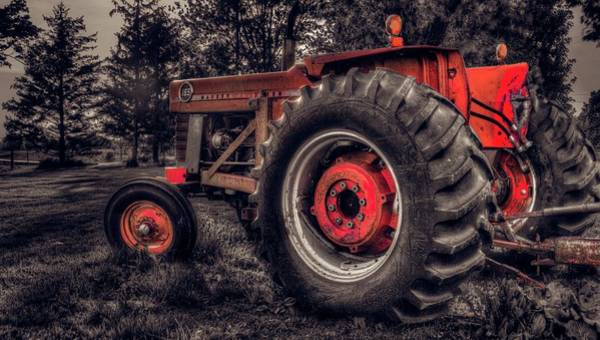 Photograph - Farm Tractor by Garvin Hunter