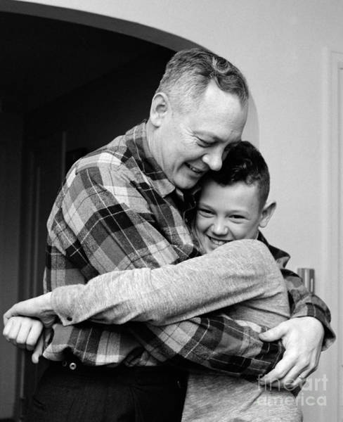 Fathers Day Photograph - Father And Son Embracing, C.1950-60s by H. Armstrong Roberts/ClassicStock