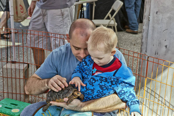 Petting Zoo Photograph - Father And Son With Tortoise by Inga Spence
