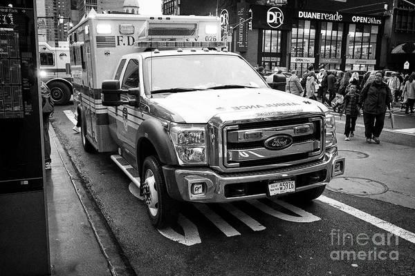 Wall Art - Photograph - fdny ambulance on call parked on city street New York City USA by Joe Fox