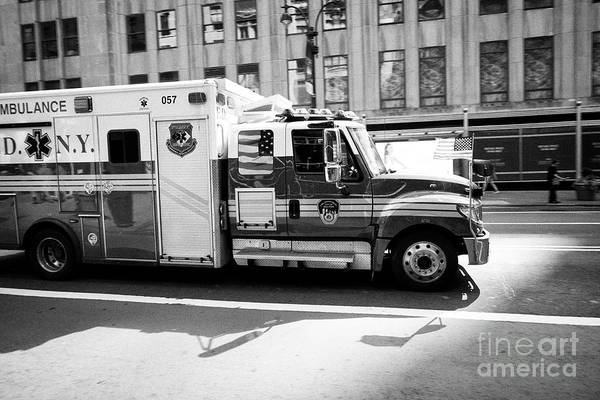 Fdny Photograph - Fdny Ambulance Speeding Through City Streets New York City Usa by Joe Fox