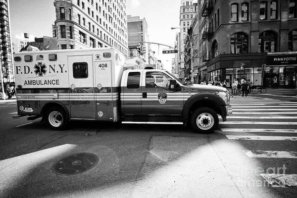 Fdny Photograph - fdny ambulance speeding through New York City USA by Joe Fox